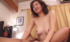 Mature Japanese housewife with a pair of nice breasts makes love to her husband