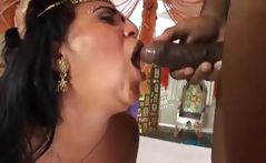 Brunette Indian babe dances and gets two cocks pounding her with a DP