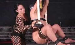 Nasty brunette mistress violates her male slave's derriere