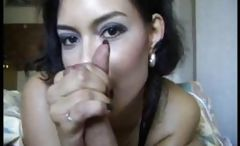 Pretty girl with dark hair strokes on his penis until he explodes