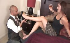 Cute brunette gets the butler to take off her heels and kiss and lick her sexy feet