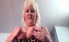 Busty old woman shows her massive tits and